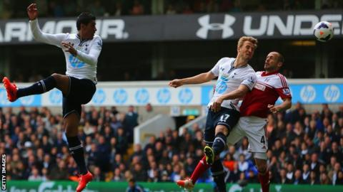Tottenham striker Harry Kane (second right) heads in his side's second goal against Fulham