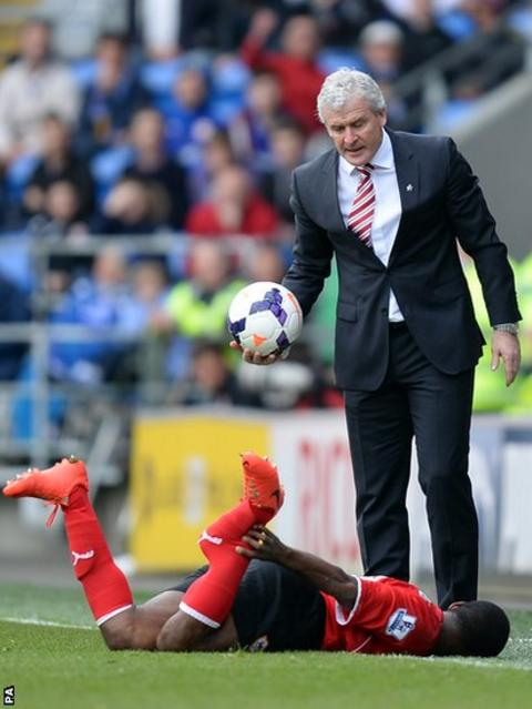 "Stoke City manager Mark Hughes looks down at Cardiff's Kevin Theophile Catherine after he was tackled by Stoke City""s Glenn Whelan"