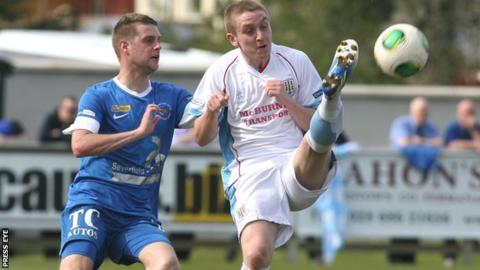 Ballinamallard's Liam McMenamin puts pressure on Alan Teggart