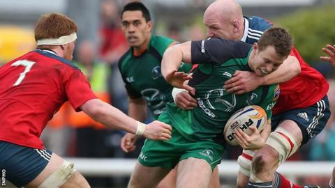 Connacht's Matt Healy is tackled by Munster lock Paul O'Connell