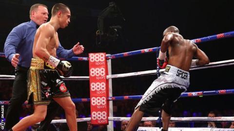 Scott Quigg knocks down Tshifhiwa Munyai.