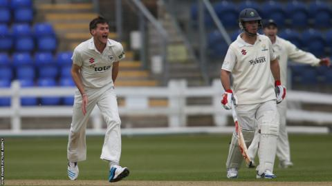 Gloucestershire's David Payne celebrates after Mark Wallace is out for a golden duck as Glamorgan end a rain affected day on 47 for 6
