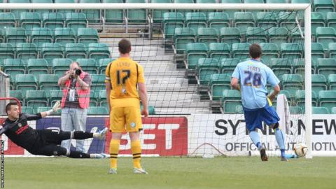 Michael Symes equalises from the penalty spot for Burton sending Newport goalkeeper Lenny Pidgeley the wrong way