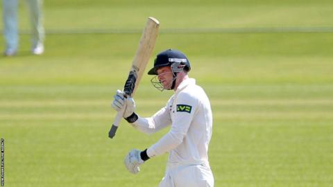 Graham Wagg celebrates after scoring 50 runs as Glamorgan fight back in their LV County Championship Division Two clash against Gloucestershire at the Swalec Stadium