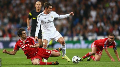 Gareth Bale takes on Bayern Munich's Javi Martinez and Philipp Lahm after coming off the bench in Real Madrid's 1-0 win in the Champions League semi-final first leg.