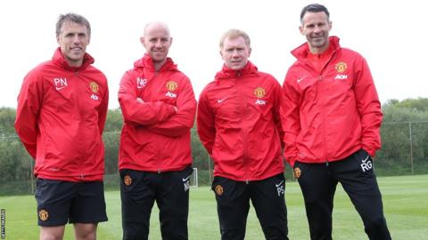 Interim Manchester United manager Ryan Giggs on the training ground with his coaching staff Phil Neville, Nicky Butt and Paul Scholes