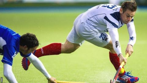 Scotland's Gavin Byers (right) is tackled by Rey Lucas of Argentina