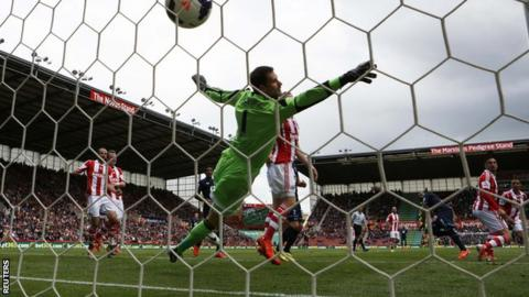 Danny Rose (third right) heads in a goal for Tottenham at Stoke