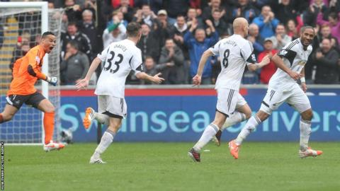 Jonjo Shelvey is chased by Swansea team-mates after restoring his side's lead over Aston Villa with a wonder goal.