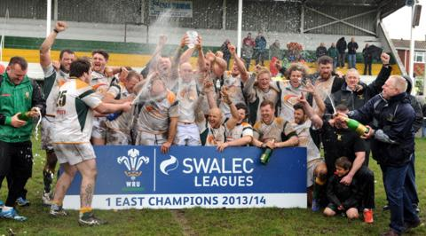 Welsh Rugby Union Division One South East champions Merthyr RFC celebrate after being presented with the trophy