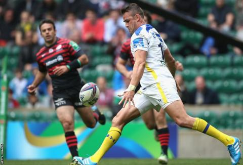 Welsh full-back Lee Byrne attempts to kick the ball upfield in Clermont Auvergne's heavy Heineken Cup defeat to Saracens at Twickenham.