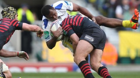 Schalk Brits tackled Sitiveni Sivivatu as Kelly Brown (left) looks on