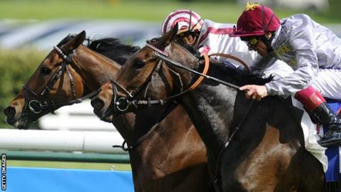 Christophe Soumillon riding Cirrus Des Aigles (L) win The Prix Ganay from Treve and Frankie Dettori