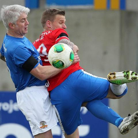 Glenavon's William Murphy challenges his former Linfield team-mate Peer Thompson at Mourneview Park