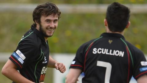 Fra McCaffrey celebrates with team-mate David Scullion after putting Glentoran into the lead at Portadown