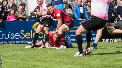 Mark Foster celebrates as Nicky Griffiths goes over for Jersey