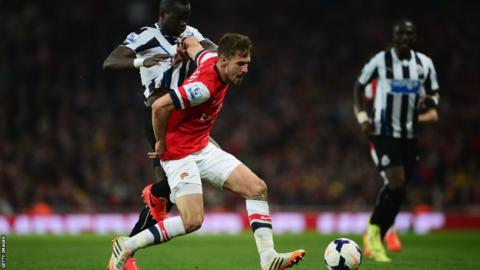 Wales and Arsenal midfielder Aaron Ramsey in Premier League action for the Gunners against Newcastle United