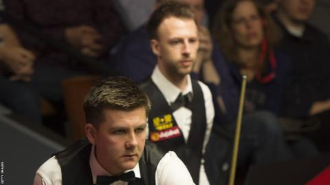 Ryan Day prepares to play a shot in his second round defeat to Judd Trump at the World Snooker Championships in Sheffield