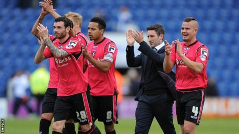 Lee Johnson and his Oldham squad