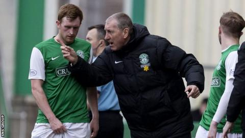 Terry Butcher passes on instructions to captain Liam Craig