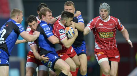 Jordan Williams runs into trouble from the Dragons defence in Scarlets' 34-23 win in the Pro12