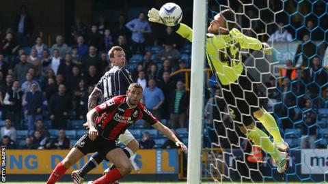 Martyn Woolford glances a header past Lee Camp to give Millwall the lead