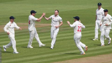 Glamorgan's Graham Wagg celebrates as he takes the wicket of Worcestershire's Alex Hales in the County Championship at Swalec Stadium