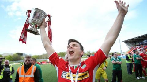 Diarmuid O'Carroll holds the Gibson Cup after Cliftonville's Premiership title triumph this year
