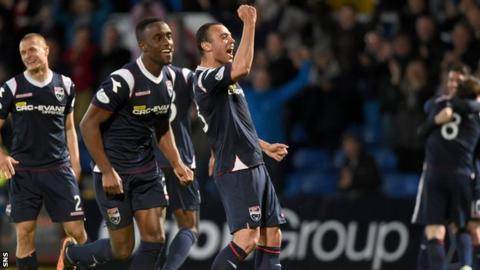 Ross County players celebrate after securing their Scottish Premiership status