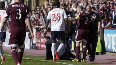 Jamie Hamill leaves Derek Adams on the ground