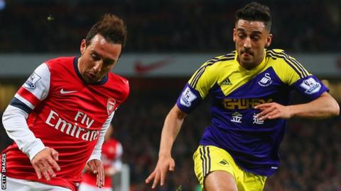 Santi Cazorla of Arsenal and Neil Taylor of Swansea City