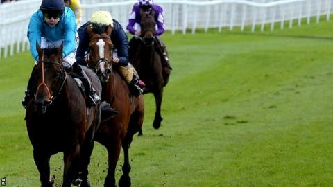 Brown Panther (left) ridden by Richard Kingscote wins the Ormonde Stakes