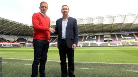 Garry Monk shakes the hand of chairman Huw Jenkins after he was confirmed as Swansea City's permanent manager.