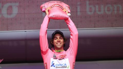 Australian Michael Matthews celebrates after taking the leader's pink jersey following the second stage of the Giro d'Italia in Belfast