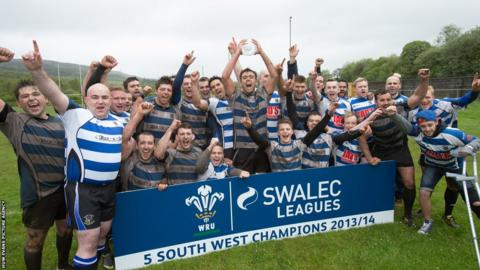 Ystradgynlais RFC players celebrate winning the SWALEC Division 5 South West title.