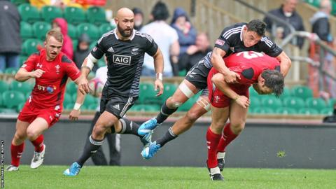 Adam Thomas is tackled during Wales' pool match against New Zealand in the London leg of the IRB Sevens World Series at Twickenham.