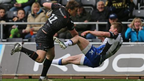 Ospreys wing Jeff Hassler sends Connacht's Eoin Griffin flying as he heads to the line in the Pro12