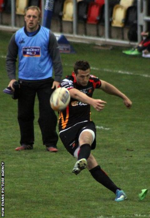 Fly-half Jason Tovey adds a conversion during Dragon's narrow 20-19 win over Treviso at Rodney Parade.