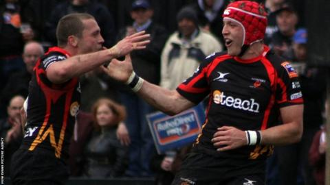 Tyler Morgan celebrates with team-mate Richie Rees after scoring Dragons' first try against Treviso.
