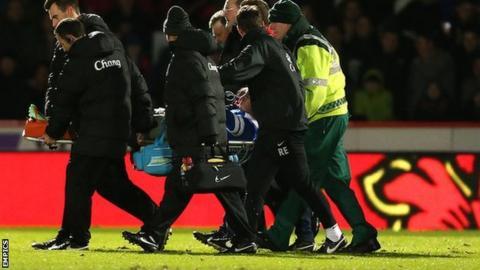 Bryan Oviedo taken off on a stretcher