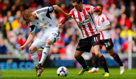 Jay Fulton, making his first start for Swansea City, gets stuck in with Sunderland's Adam Johnson.