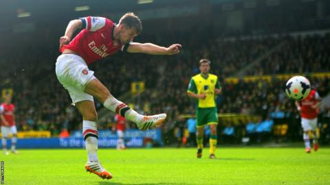 Aaron Ramsey scores with a spectacular volley to give Arsenal the lead against Norwich City at Carrow Road.