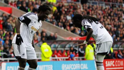 Bony celebrates his goal with fellow goalscorer Marvin Emnes as Swansea end the season with a 3-1 win.