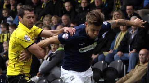 Burton's Phil Edwards holding on to Southend United's Kevan Hurst