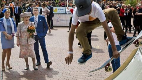 """Princess Beatrix of the Netherlands, her son Prince Constantijn and his wife Princess Laurentien look at a skateboard demonstration during the first King""""s Day in Amstelveen"""