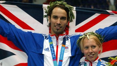Nathan Robertson celebrates his Olympic silver medal in Athens