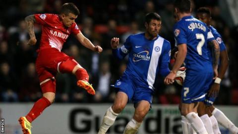 Dean Cox scores against Peterborough