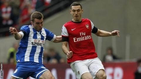 Arsenal's Belgian defender Thomas Vermaelen (left) vies with Wigan Athletic's striker Callum McManaman