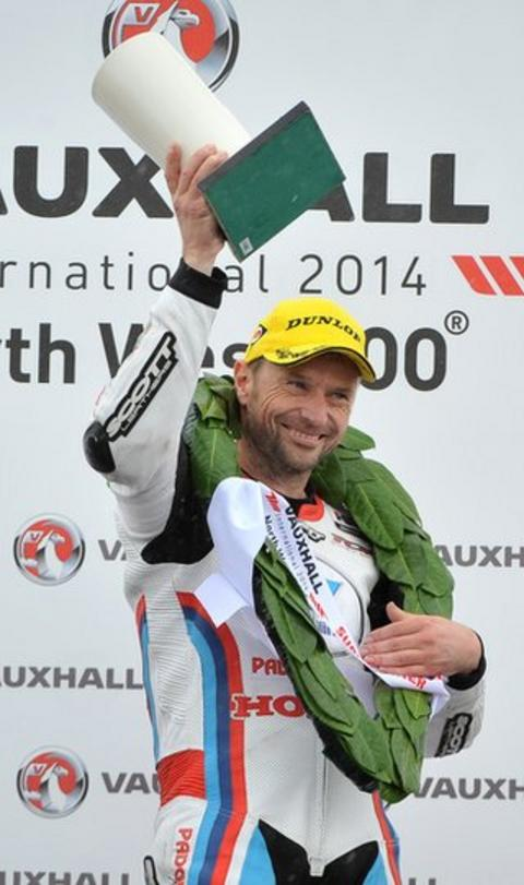 A delighted Bruce Anstey celebrates winning the Supersport race after leaders Lee Johnston and Alastair Seeley crashed out on the final lap