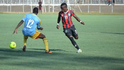 Malawi's Frank 'Gabadinho' Mhango (number 11)